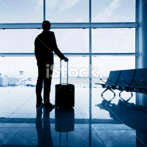 stock-photo-21650635-businessman-in-the-airport